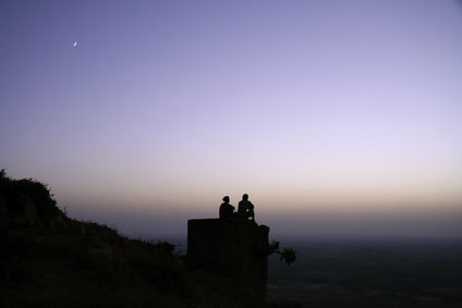 couple chilling out on top of hill
