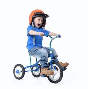 Little boy riding bicycle on white background