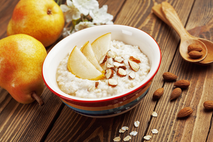 Oatmeal with pear and almonds in the bowl