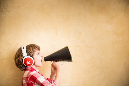 Kid listen music at home. Hipster child with retro vintage speaker
